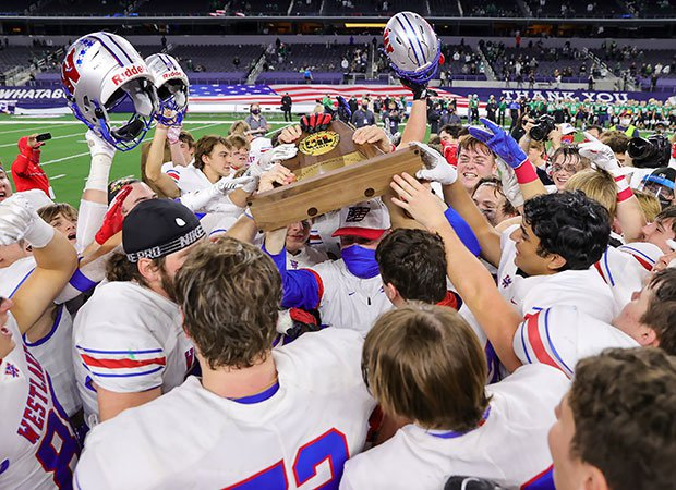 Westlake players celebrate their 6A Division 1 title win Saturday over Southlake Carroll.