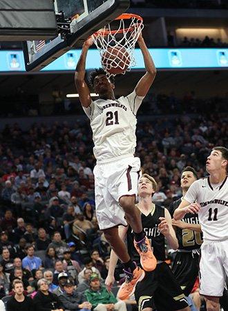 Jordan Brown finishes a dunk for two of his game-high 35 points for Woodcreek.