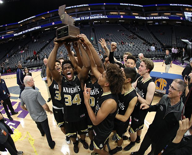 Bishop Montgomery players proudly hoist the championship trophy.