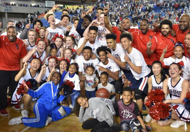 No. 1 Nathan Hale celebrates its 68-51 win over Garfield (Seattle) in Washington's Class 3A state title game Saturday. The Raiders finished 29-0 a year after going 3-18.