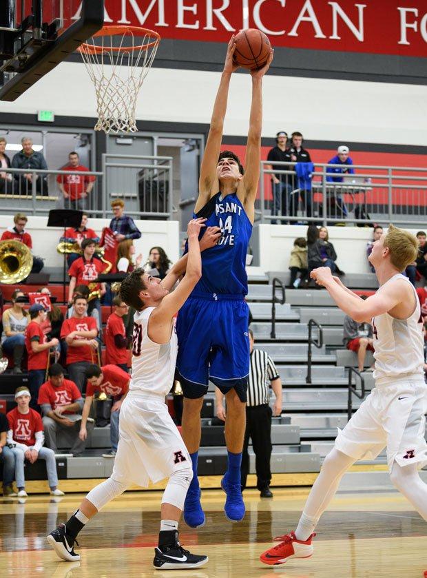 The long reach of 7-3 junior Matt Van Komen, Pleasant Grove (Utah).