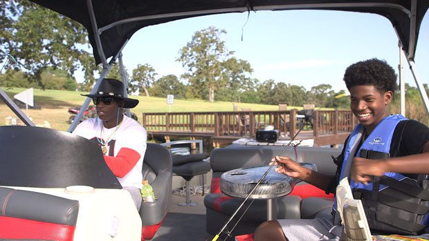 Deion Sanders and his freshman son Shedeur Sanders enjoy the afternoon fishing.