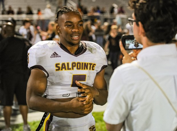 Bijan Robinson talks to the media after piling up 299 all-purpose yards in a win over Sahuaro earlier this month.