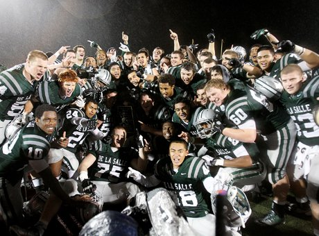 De La Salle celebrates after winning its 21st straight North Coast Section championships on Saturday. Now the Spartans face their toughest task, traveling to hostile Sacramento State where more than 20,000 fans will likely be rooting almost exclusively for Folsom in the CIF Northern California State Regional Open Division Football Bowl Game.