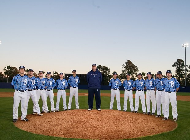 Barbe coach Glenn Cecchini with the 2014 team, the first of three straight state championship teams.