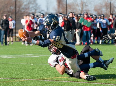 Needham's Mike Panepinto stretches out for one of his five touchdowns in 39-21 victory on Thursday.