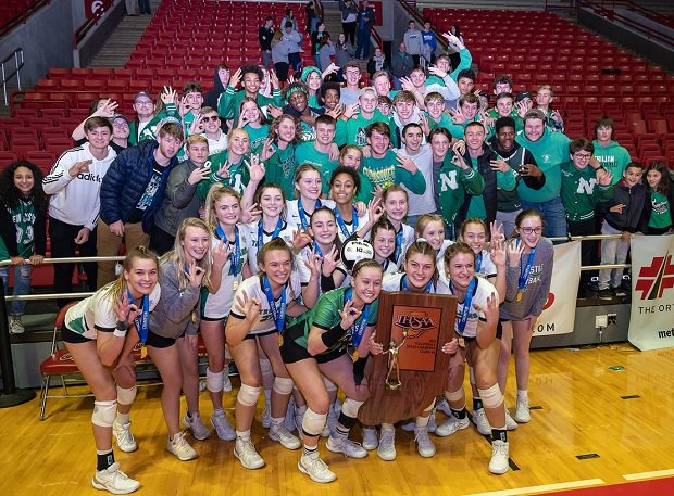 New Castle poses with its fans after winning the Indiana 4A state title.