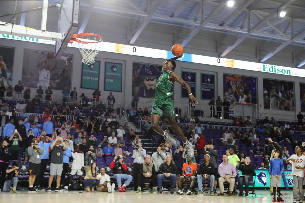 Malachi Wideman soars for a dunk Sunday in Fort Myers, Fla.