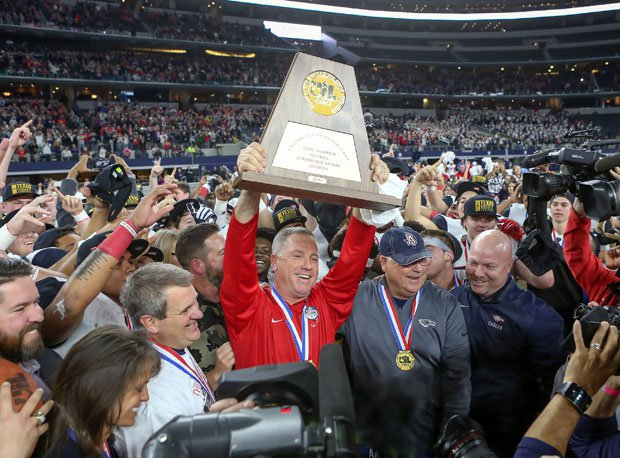 Allen coach Terry Gambill celebrates his team's UIL Texas 6A-1 championship on Saturday.
