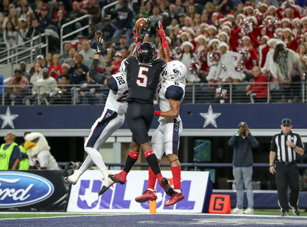 Lake Travis' Garrett Wilson (5) goes up high with Allen's Taj Bickham and Tkai Lloyd.