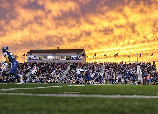 A fiery Missouri sky is the backdrop for the battle between host Lee's Summit West and Staley.