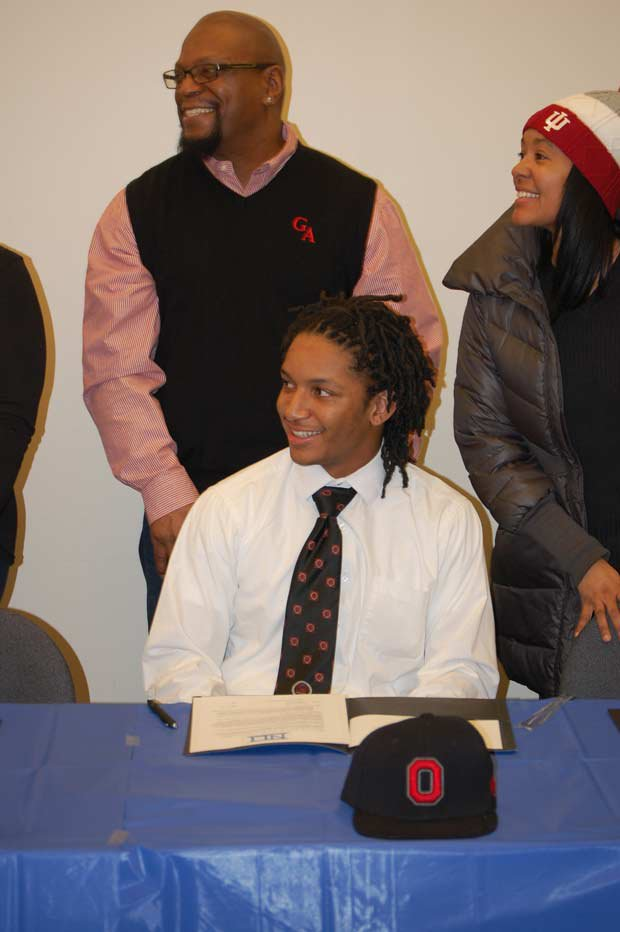 Erick Smith of Glenville (Cleveland) smiles as he preps to sign with Ohio State.
