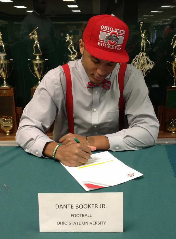 Dante Booker Jr. of St. Vincent-St. Mary (Akron, Ohio) signs with Ohio State.