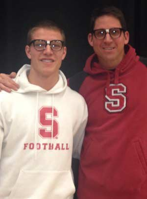 Christian McCaffrey of Valor Christian (Highlands Ranch, Colo.) poses with his dad, Stanford alum Ed McCaffrey, during a ceremony where he himself signed with the Cardinal.