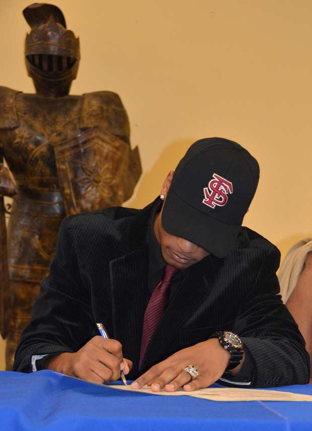 Travis Rudolph of Cardinal Newman (West Palm Beach, Fla.) signs with Florida State.