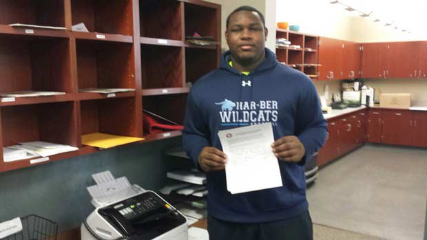 Josh Frazier of Har-Ber (Springdale, Ark.) prepares to fax his National Letter of Intent to Alabama.