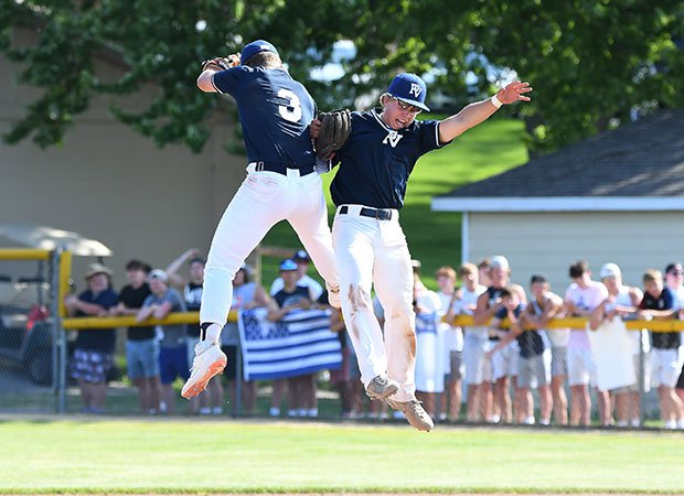 Two Pleasant Valley players celebrate the victory.