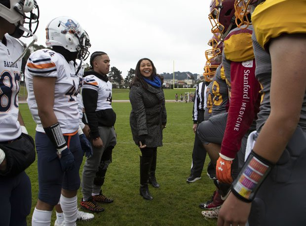 San Francisco Mayor London Breed with the opening coin toss before Thursday's 96th San Francisco Section championship game.