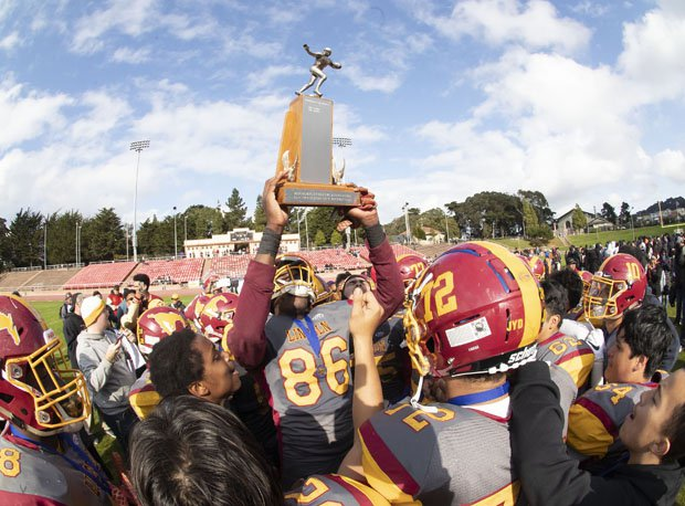 Lincoln's James Walsh (86) hoists the San Francisco Section championship trophy, the Mustangs' second straight title and eighth since 2005.