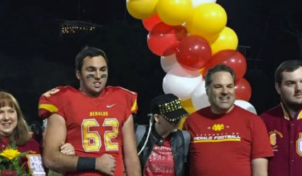 The Schemmer family surrounds Abbey (middle) during a Whittier Christian football game last season.