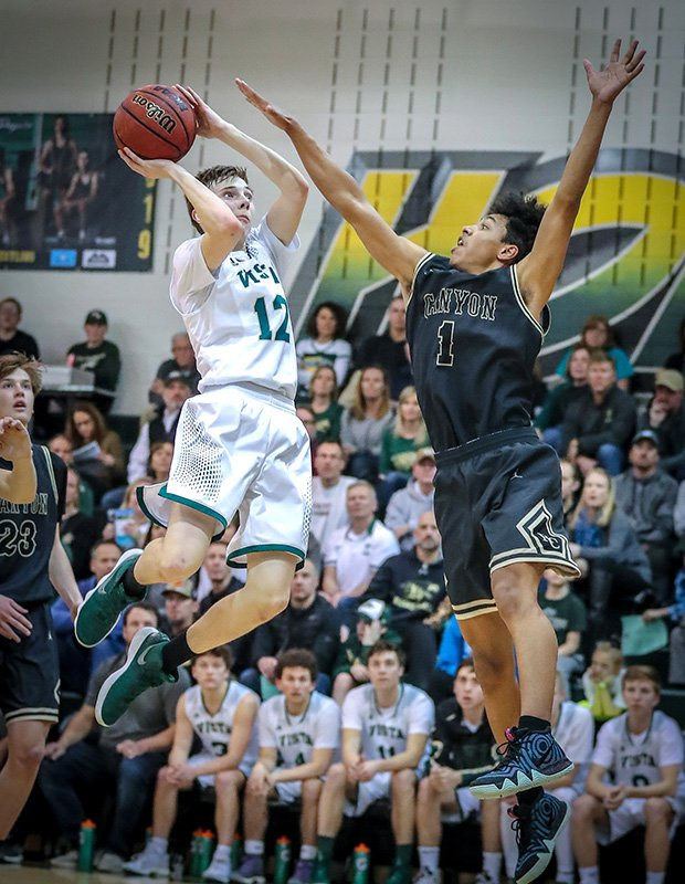Rhys Pulling of Mountain Vista (Colo.) takes a running shot while defended by Jalen Ashley of Rock Canyon.
