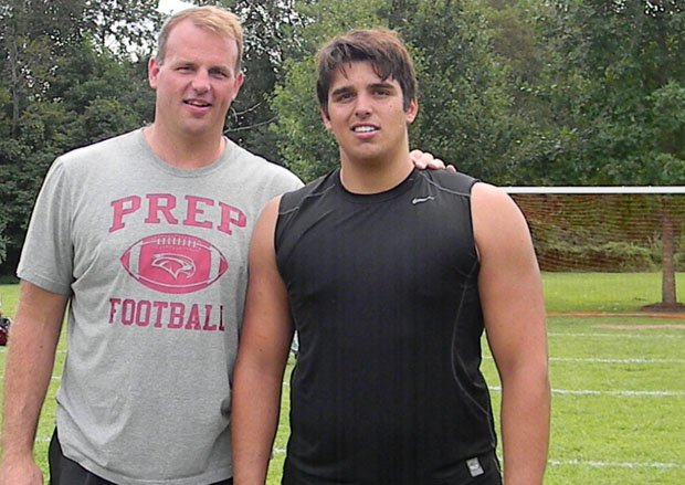 Jon Daniel Runyan (right) with his father and former NFL lineman Jon Runyan.