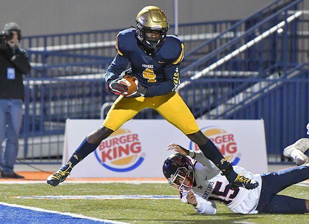 Receiver Marcus Rosemey catches a first-half touchdown for Aquinas.