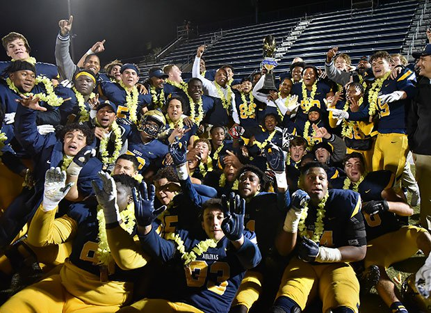 Aquinas players celebrate their GEICO State Champions Bowl Series victory in Las Vegas.