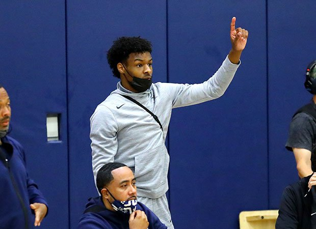 Sierra Canyon's Bronny James motions to his teammates on the court.