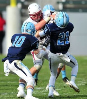 Corona del Mar's Brett Greenlee (10) and Chad Redfearn (21) take on a SHP player.