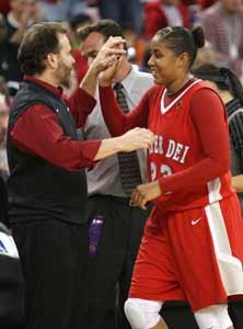 Greeted by coach Kevin Kiernan, Kaleena Mosqueda-Lewis leaves the court for the last time with a 123-7 record and two national crowns.