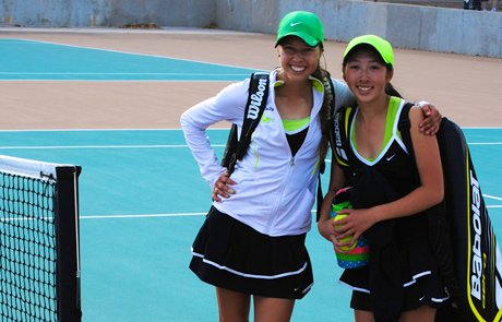 """Molly Merrion, left, and Danielle Nguyen didn't buy in to the theory that Farmington tennis was going to be """"down"""" this year. They're undefeated and look to take the state title again."""