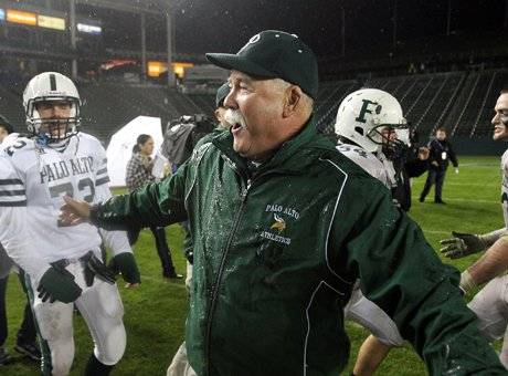 Palo Alto football coach Earl Hansen celebrates shortly after being doused by Gatorade following a State Bowl title win over Centennial (Corona, Calif.) in 2010. Hansen's career started with another joyous moment: Coaching 49ers' coach Jim Harbaugh in his initial season in 1980.