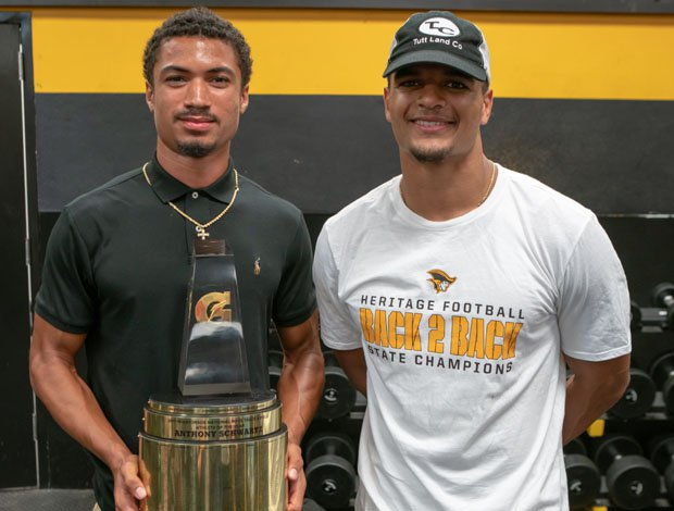 Minkah Fitzpatrick (left) and Anthony Schwartz pose Thursday after the recent American Heritage sprinter and football player won the Gatorade Male Track and Field Athlete of the Year award.