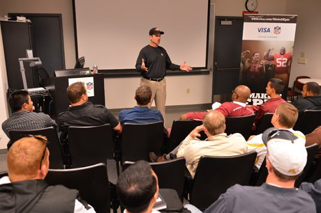 San Francisco 49ers coach Jim Harbaugh met with two dozen Bay Area High School football coaches to talk about leadership, teaching and building relationships.