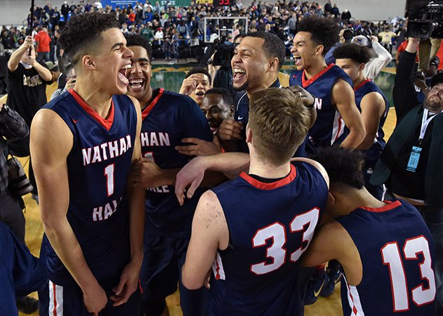 Michael Porter Jr. (left) celebrates with teammates and head coach Brandon Roy after defending Garfield in the state championship game Saturday night at the Tacoma Dome.