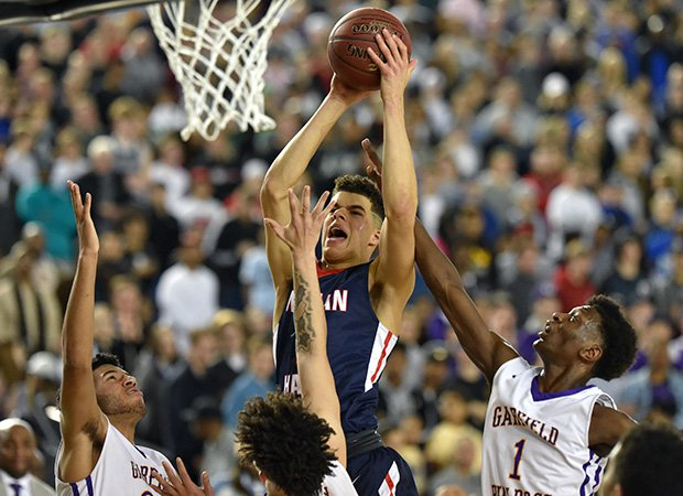 Michael Porter Jr. of Nathan Hale drives to the basket while surrounded by three Garfield defenders.