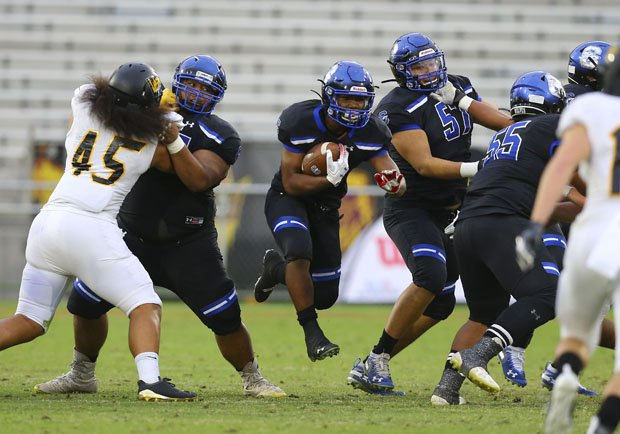 Chandler uses a strong running game throughout to roll to its 26th straight victory and an Arizona Open Division state title.
