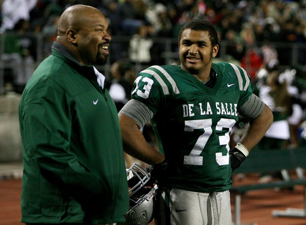 Larry Allen Jr. (left), who was just inducted into the NFL Hall of Fame over the summer, enjoys a moment with his son Larry III during a De La Salle football game.