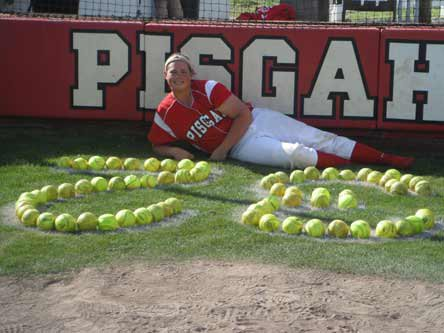 Shelby Holley, shown here with her jersey number written with softballs, hopes to have her number retired at Pisgah (Ala.). Setting the national home run record should do the trick.