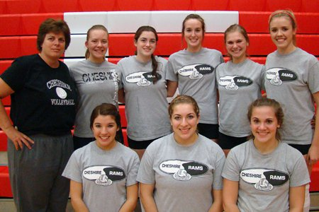 Cheshire volleyball coach Sue Bavone, left, and her eight senior girls. Bavone is attempting to go undefeated with both the boys and girls teams at Cheshire in 2011.