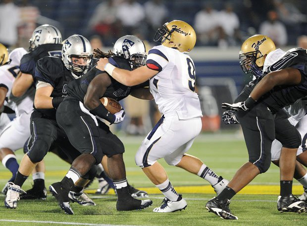Kyle Snyder (9) wrestled ballcarriers and linemen as a nose guard for Our Lady of Good Counsel.