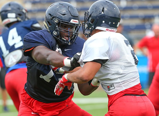 Offensive guard E.J. Ndoma-Ogar (left) sqaures off with a teammate during spring drills.