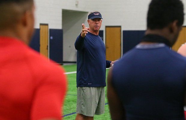 Head coach Terry Gambill gives instruction to players during spring drills.