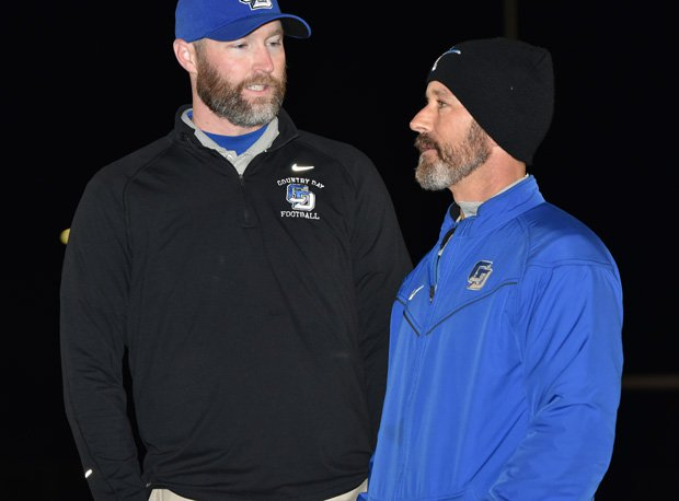 Special Teams Coordinator Robert Grasso (right) talks with coach Hales.