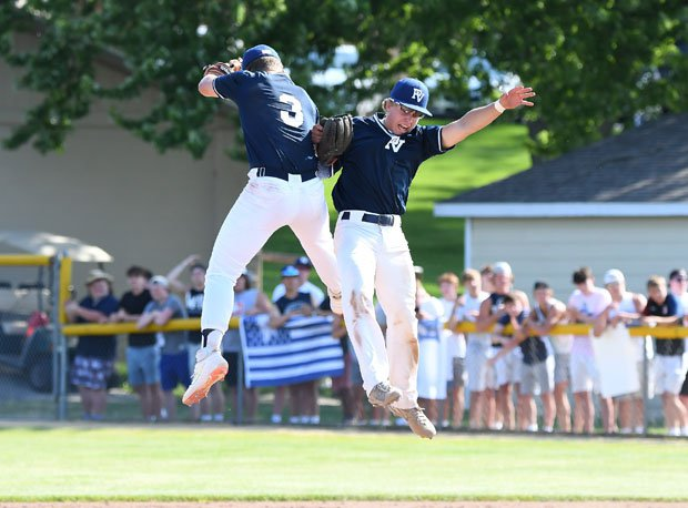 In return to action on June 15 in Iowa, two Pleasant Valley celebrate a 3-2 win over Assumption (Davenport).