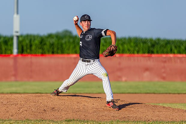 A Clinton pitcher gets ready to fire toward home plate earlier this season against Davenport West.