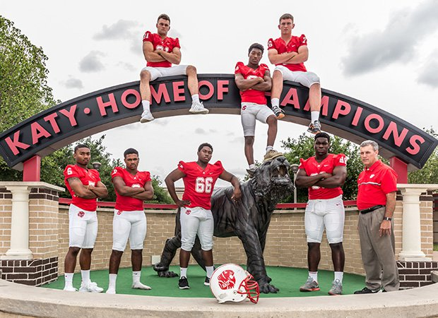 Head coach Gary Joseph (right) stands along with several top returning players.