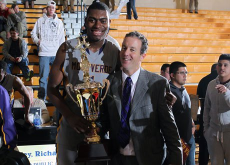 Tournament MVP Dakari Johnson and head coach Kevin Boyle celebrate Montverde Academy's championship game victory over Lone Peak at the City of Palms Classic.