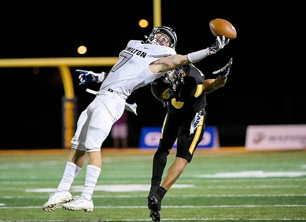 Hamilton (Ariz.) safety Jack Howell reaches in an attempt to make one-handed interception in front of a Sagauro receiver.